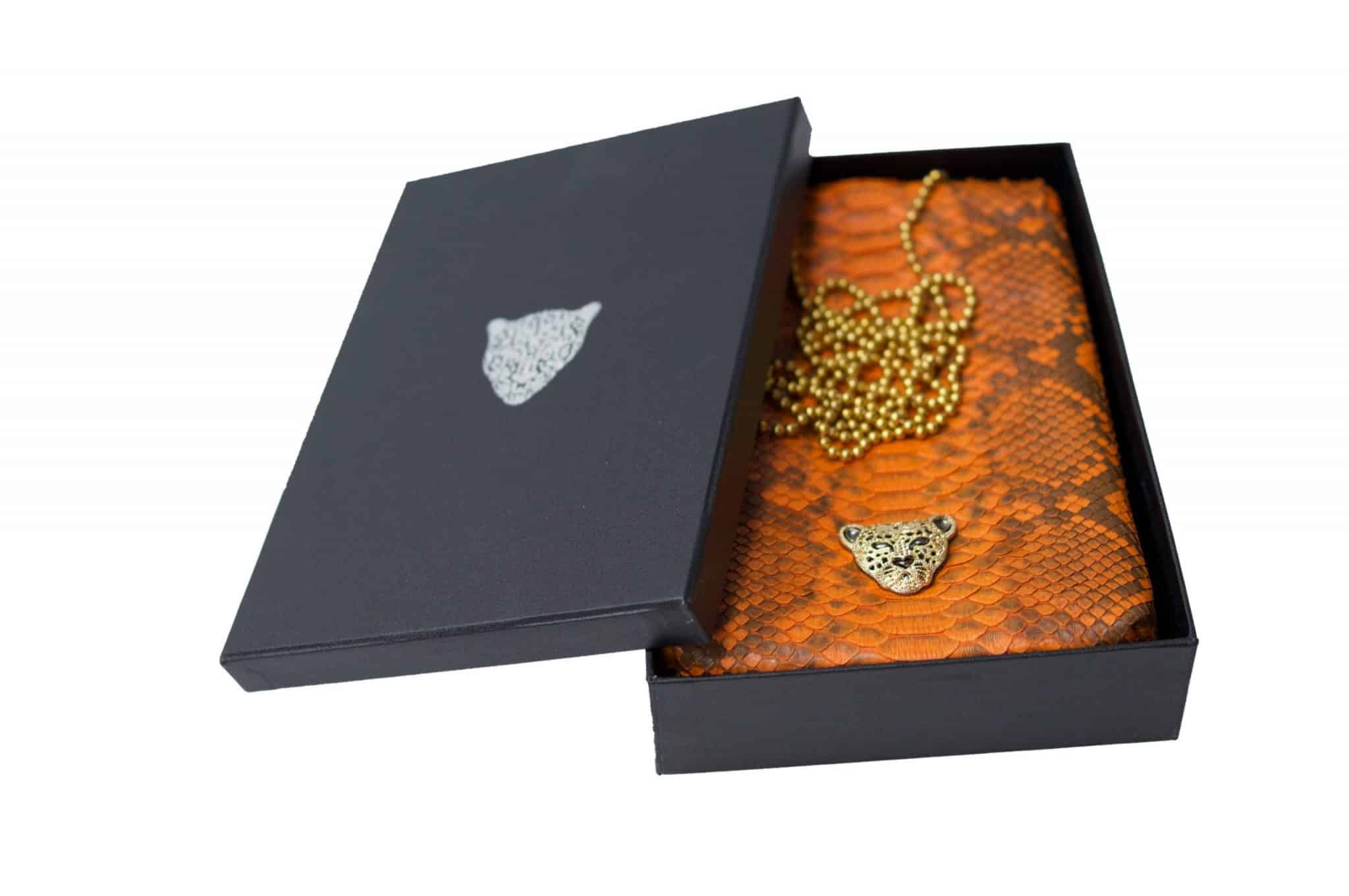 Orange Capsule Clutch gold logo RusiDesigns