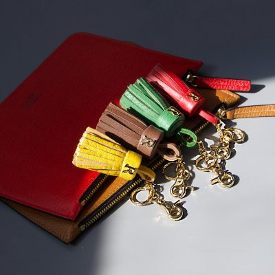 leather pouch and tassel keyrings
