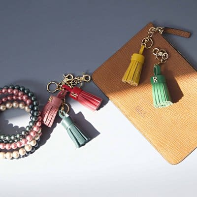 Tan leather pouch wallet and tassels keyrings